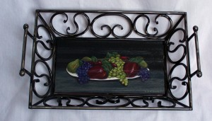 Still life painting of fruit on a wrought iron tray